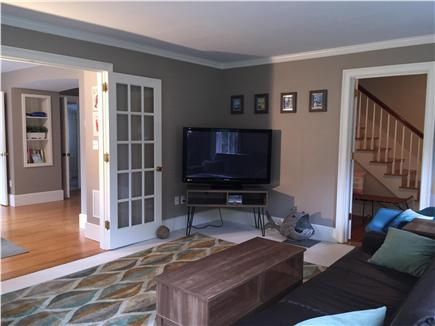 Yarmouthport Cape Cod vacation rental - Living room looking into dining area and pantry and W/D beyond