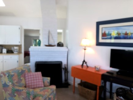 East Brewster Cape Cod vacation rental - Cozy seating area with wood burning fireplace and flat screen TV