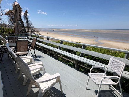 East Brewster Cape Cod vacation rental - Spacious deck overlooking the bay with a stairway to the beach.