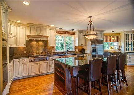 Barnstable Cape Cod vacation rental - Granite island features 6 leather stools.