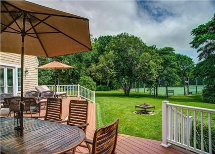 Barnstable Cape Cod vacation rental - Large back deck is great for lounging and dining.