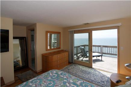 East Falmouth Cape Cod vacation rental - A double bed and private balcony with ocean view in the master
