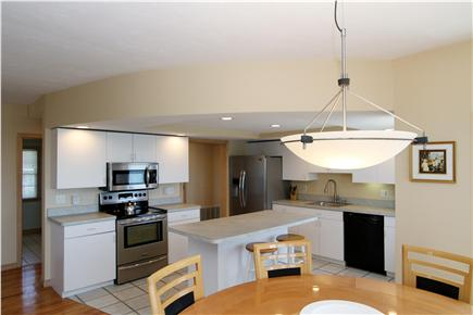 East Falmouth Cape Cod vacation rental - Kitchen opens onto dining room.