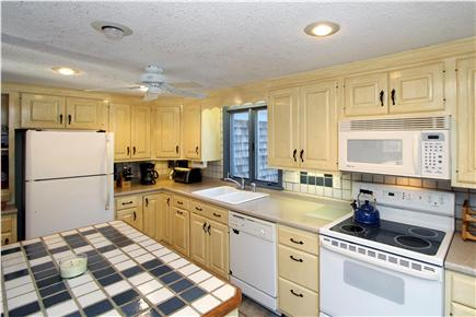 Eastham Cape Cod vacation rental - This charming kitchen has sunny colors and modern appliances.