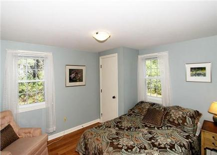 Chatham Cape Cod vacation rental - A quaint third bedroom with a double bed and reading chair.