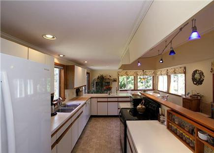 Chatham Cape Cod vacation rental - A galley-style kitchen offers tons of counter space and open desi