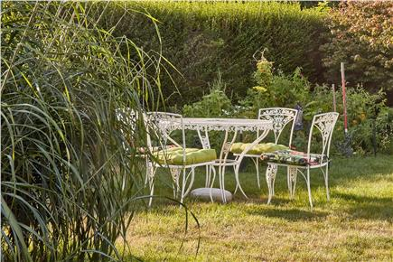 Falmouth Cape Cod vacation rental - Garden seating in large backyard
