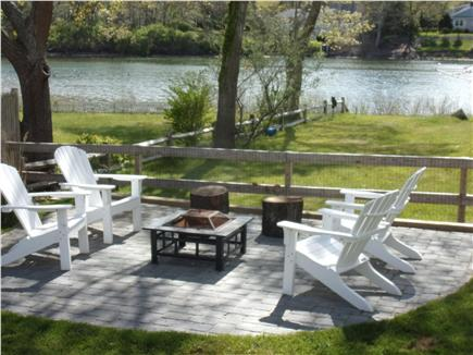 Falmouth Cape Cod vacation rental - Adirondacks around firepit, with fenced in yard