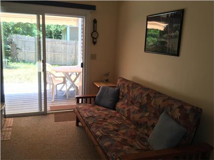 mashpee Cape Cod vacation rental - The breezeway with futon & sliders to the patio