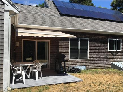 Mashpee Cape Cod vacation rental - The private patio with table, chairs, and gas grille