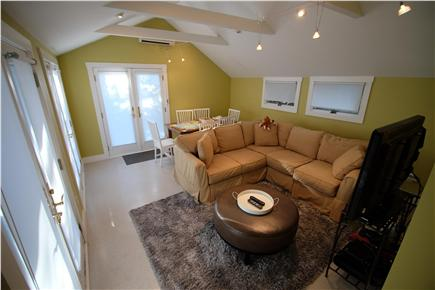 Provincetown Cape Cod vacation rental - Den/TV/game room with multiple French doors to outside grounds.