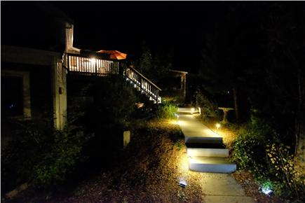 Provincetown Cape Cod vacation rental - Path to stairs and entry and dining deck at night.