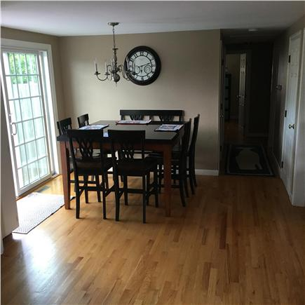 West Dennis Cape Cod vacation rental - Kitchen dining area with access to the deck