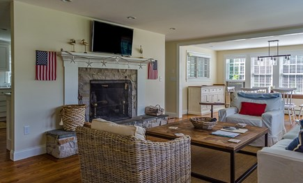Harwich Cape Cod vacation rental - Living Room with Field Stone Fireplace open to Dining Area