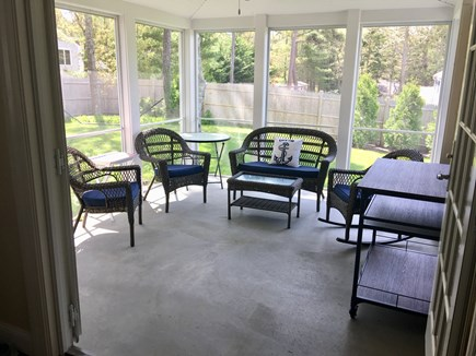 Harwich Cape Cod vacation rental - Screened In Porch Overlooking Fenced Back Yard