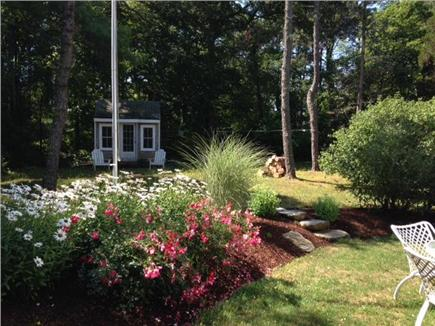 East Orleans Cape Cod vacation rental - Beautiful plantings next to outdoor patio table with umbrella