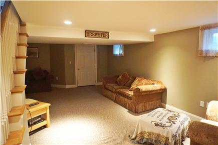 Brewster Cape Cod vacation rental - Basement living space with full bath and cable flat screen tv