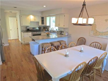Orleans Cape Cod vacation rental - Main house kitchen and dining area -- open, bright and social