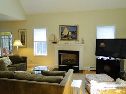 West Falmouth near Old Silver  Cape Cod vacation rental - Vaulted living room with TV and fireplace