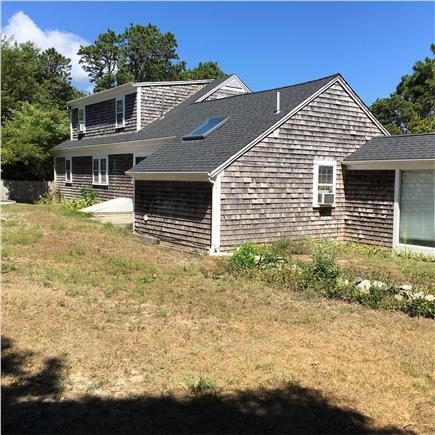 Harwichport/So Harwich, on cul Cape Cod vacation rental - Back of main house w/part of brzway to So Wing. Has grill & table