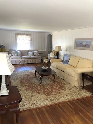 Harwichport/South Harwich Cape Cod vacation rental - Front to back LR with ample seating and fireplace.