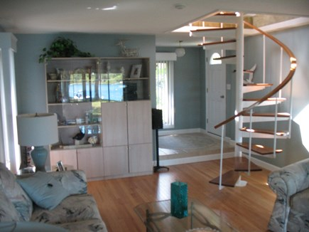 Mashpee Cape Cod vacation rental - Living room with Spiral staircase to upstairs back bedroom