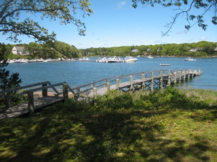 Mashpee Cape Cod vacation rental - Back yard leading to 195 dock with float