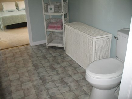 Mashpee Cape Cod vacation rental - Walk through bath to back bedroom.