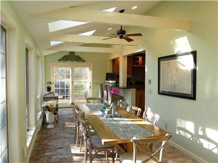 Barnstable Cape Cod vacation rental - Dining area facing kitchen, back yard living area