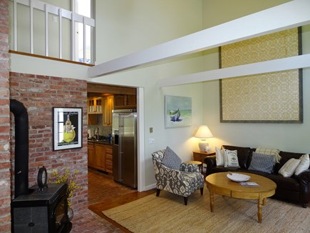 Barnstable Cape Cod vacation rental - Den area with wood stove, leads to Master suite