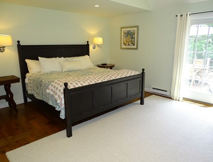 Barnstable Cape Cod vacation rental - Large master bedroom with king bed, TV and French doors to deck