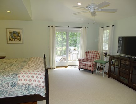 Barnstable Cape Cod vacation rental - Master bedroom with flat screen TV, slider to deck