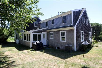 East Orleans Cape Cod vacation rental - Back exterior with rolling lawn surrounding the home
