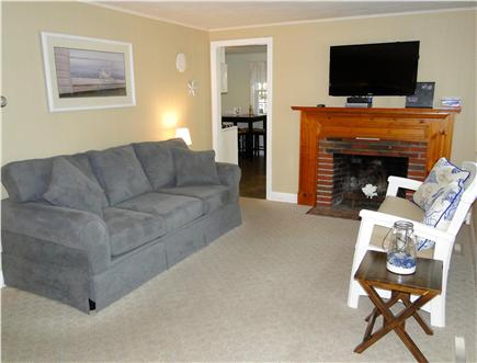 South Dennis Cape Cod vacation rental - Living room with flat screen TV, opens to kitchen