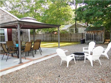 South Dennis Cape Cod vacation rental - Great side yard with covered deck area and fire pit