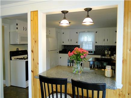 South Dennis Cape Cod vacation rental - Kitchen area view from the sun room