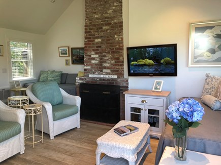 South Yarmouth Cape Cod vacation rental - Great room with fireplace, HDTV, Lloyd Flanders chairs.