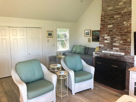 South Yarmouth Cape Cod vacation rental - Great room showing chairs, large wall closet & couch/twin bed.