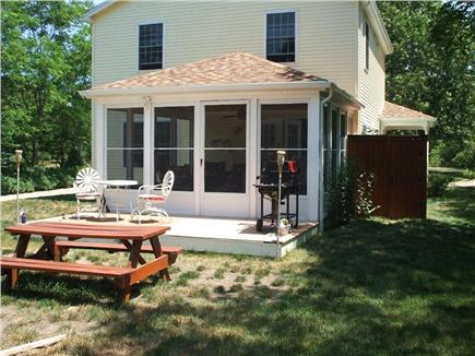 Wellfleet Cape Cod vacation rental - Back area with seating, grill, showing sun room