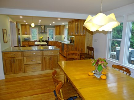 East Harwich Cape Cod vacation rental - Dining area with water views, opens to kitchen and also has slide