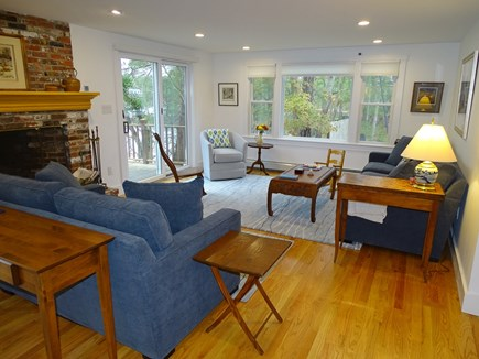 East Harwich Cape Cod vacation rental - Sunny great room with sliders to the large deck, water views, fir