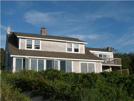 Brewster Cape Cod vacation rental - The house,sun room on left, upstairs and downstairs deck on right
