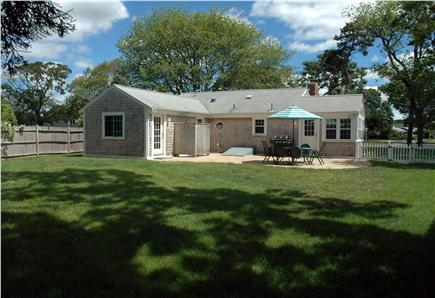 Falmouth Heights Cape Cod vacation rental - Back yard has generous patio and fencing for small kids and dogs