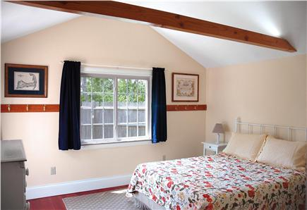 "Falmouth Heights Cape Cod vacation rental - ""Captain's Cabin"" accessible Queen bedroom has door out to patio"