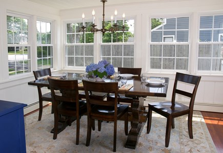 Falmouth Heights Cape Cod vacation rental - Sunny dining room seats 8 with servingware to host a party for 12