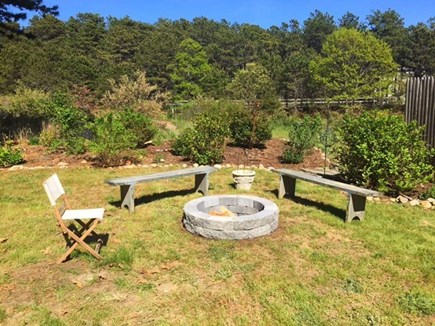 Eastham Cape Cod vacation rental - Fire pit - to the left is a hammock.