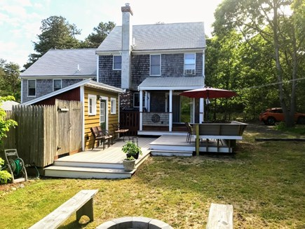 Eastham Cape Cod vacation rental - Backyard with deck and covered porch, outdoor shower, fire pit.