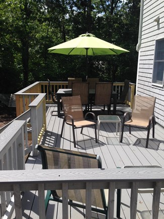 Eastham Cape Cod vacation rental - New enlarged deck with dining table, umbrella and seating area