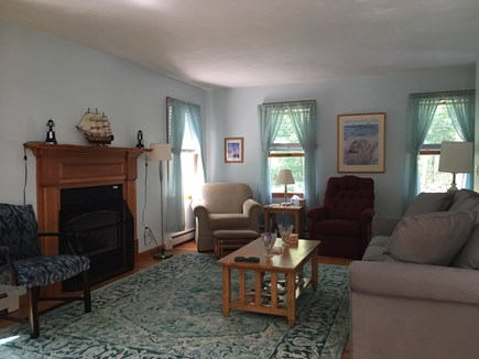 Eastham Cape Cod vacation rental - Living room showing gas fireplace, new comfy couch and chairs