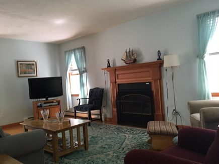 Eastham Cape Cod vacation rental - Livingroom showing gas fireplace and TV